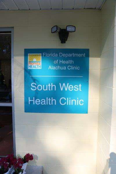 "A sign that reads ""Florida Department of Health Alachua Clinic South West Health Clinic"""