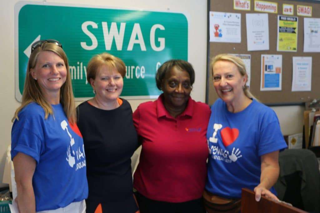 Joan in the SWAG Family Resource Center with SWAG and community leaders