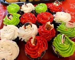 An assortment of red, green, and white cupcakes