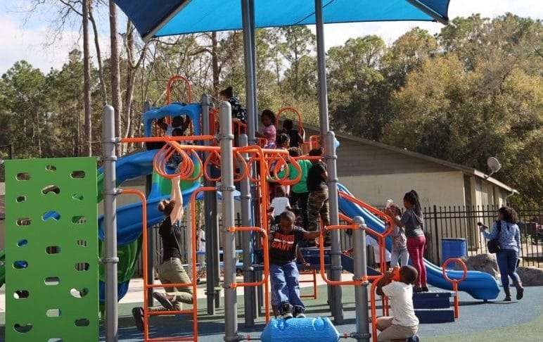 Children playing on the playground next to the SWAG Family Resource Center