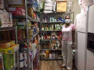 Family Resource Center manager Kristy Goldwire standing in the fully stocked food pantry inside the SWAG FRC