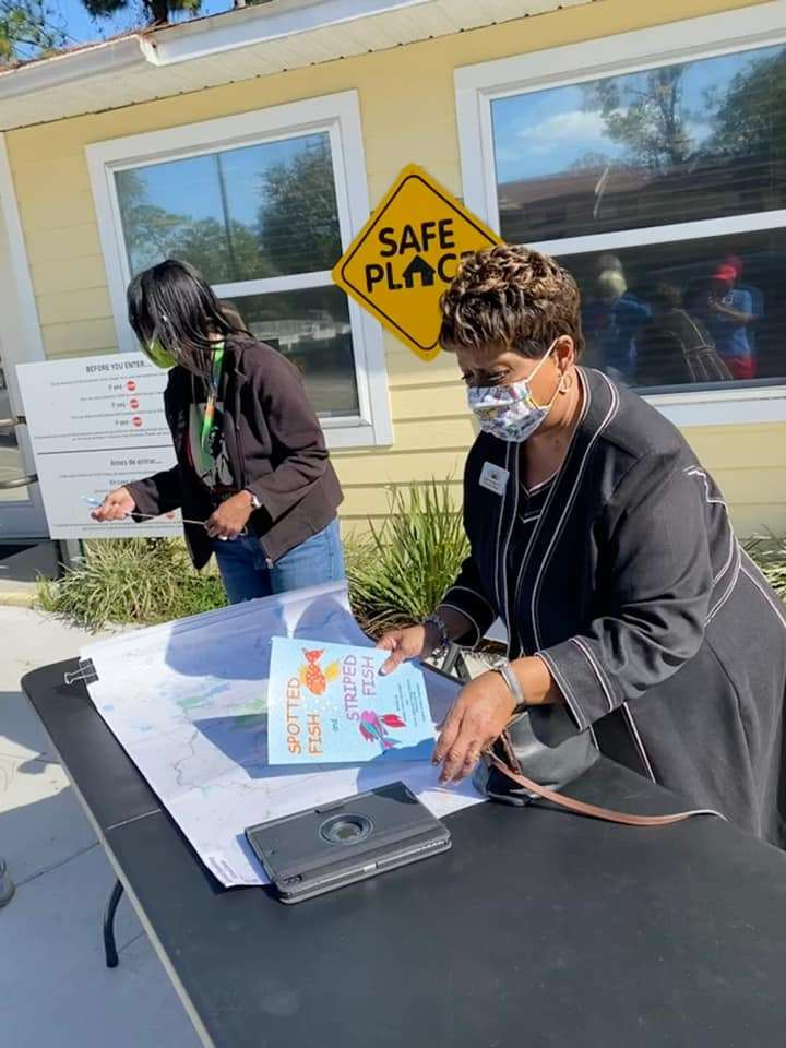 Alachua County Public School Board member Leanetta McNealy prepares to speak with SWAG families about school zoning changes