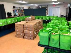 The multipurpose room in the SWAG Family Resource Center filled with bags of food for Thanksgiving 2020