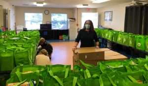 SWAG Family Resource Center staff and interns fill tote bags of food for Thanksgiving 2020