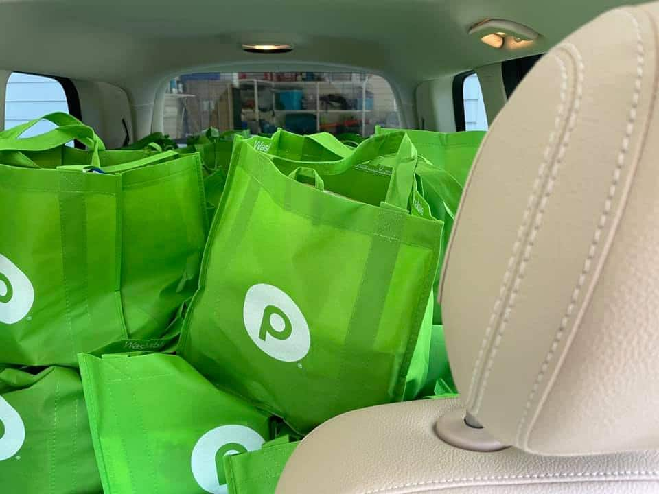 A car stuffed with bags full of Thanksgiving food, ready for distribution to 200 SWAG families