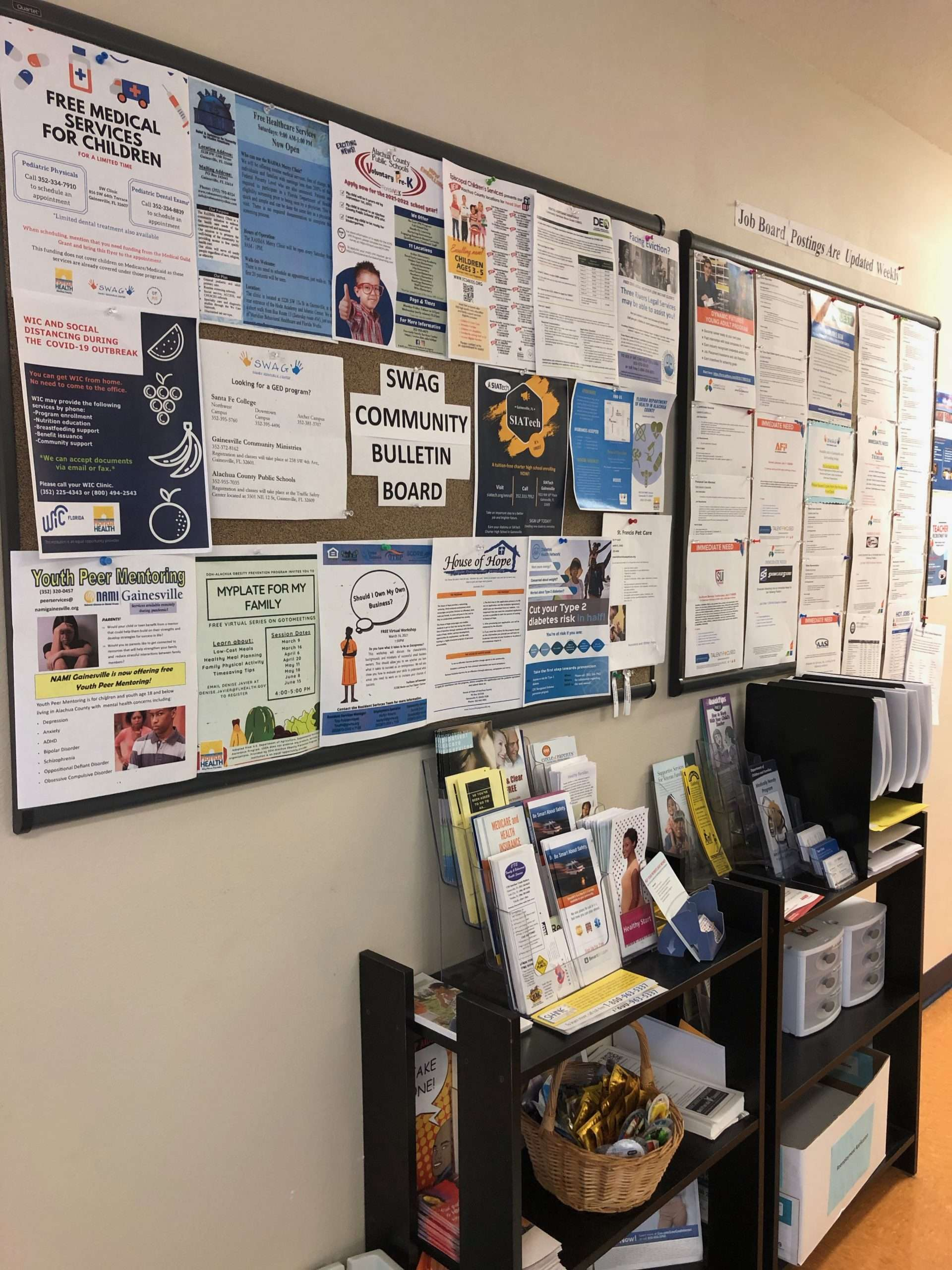 A community resource board and a job board posted in the lobby of the SWAG Family Resource Center