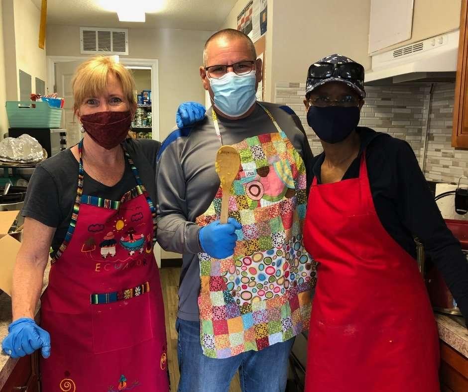 Board members Bill Gair and Michele Thomas with long-time volunteer Jane Doig preparing the April 2021 Community Dinner