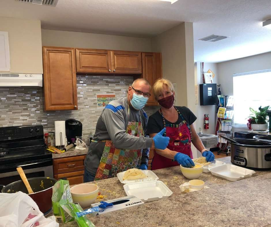 Bill Gair and Jane Doig in the SWAG Family Resource Center kitchen during the April 2021 Community Dinner