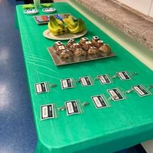 Snacks and name badges laid out on a table for the employability workshop in April 2021