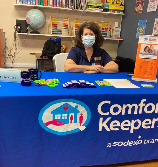 A table and representative for Comfort Keepers during the April 2021 SWAG Community Job Fair