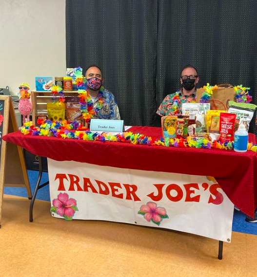 A colorful display table table and representatives for Trader Joe's during the SWAG Community Job Fair