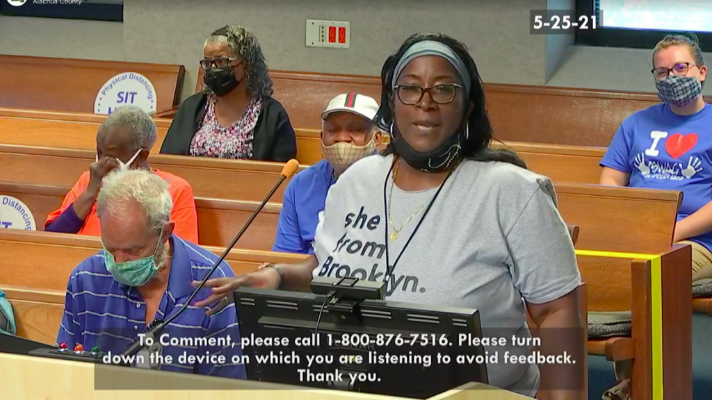 Joan Canton's daughter, Dana, speaking at the Board of County Commissioners' vote to designate a road in honor of her mother