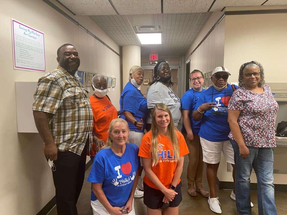 SWAG members, friends, and family of Joan Canton attend a BOCC meeting to support the naming of Joan Canton Way
