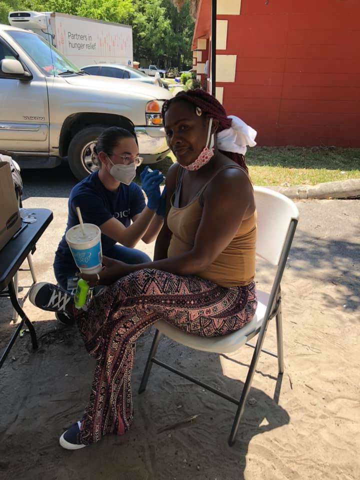 A Tower Oaks Glen community member receives a vaccine dose at a distribution event in May 2021