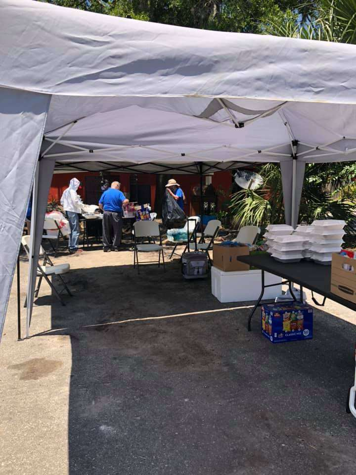 SWAG board members set up an outdoor vaccination tent in Tower Oaks Glen in May 2021
