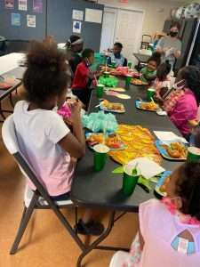 Homework Help students eat lunch together to celebrate the end of the school year in June 2021