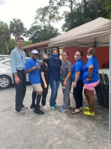 SWAG board members and UF Mobile Outreach Clinic staff pose together at the end of a Tower Oaks vaccination event