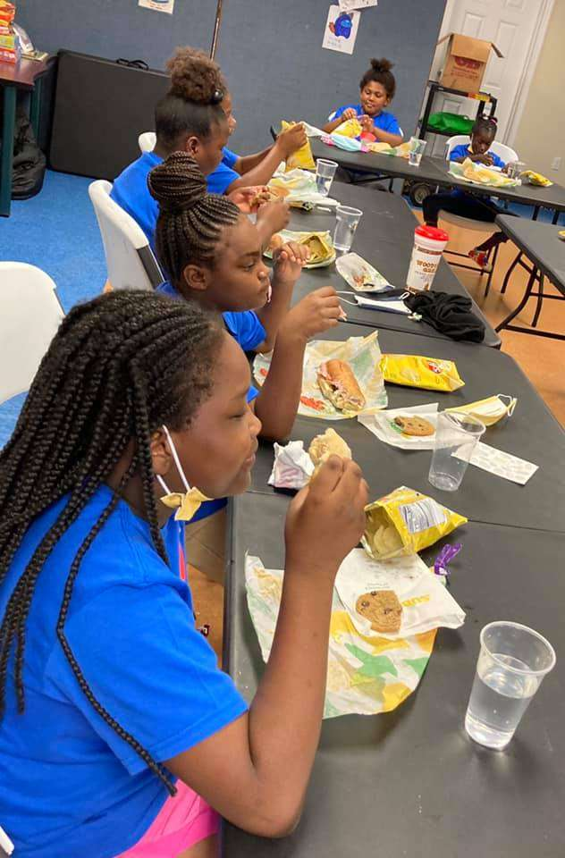 SWAG summer session students eat meals from Singleton Subways' Newberry store during a July 2021 field trip day