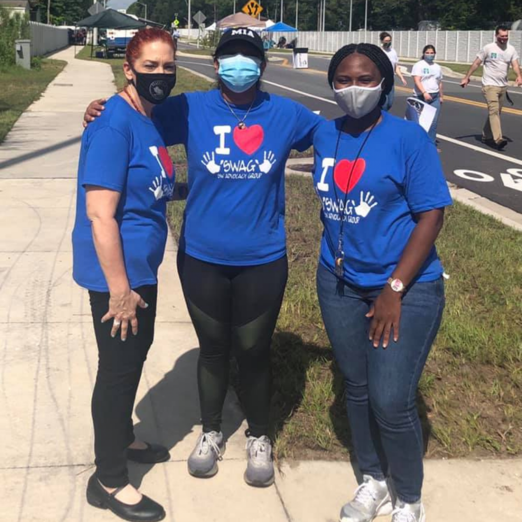 SWAG Board Member Mona Sayedul Huq stands with Family Resource Center staff Shandra Nichols and Robin Wilkerson