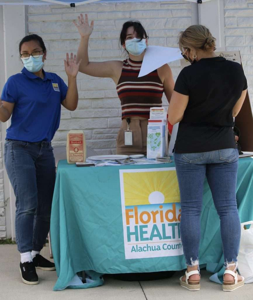 A community member visits a booth by the Alachua County Department of Health at the 2021 SWAG Community Connections celebration