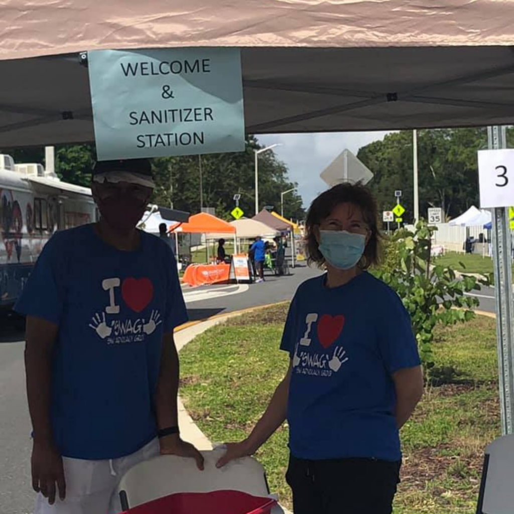 Two SWAG Board members staff a masking and sanitizing station at the Community Connections resource fair