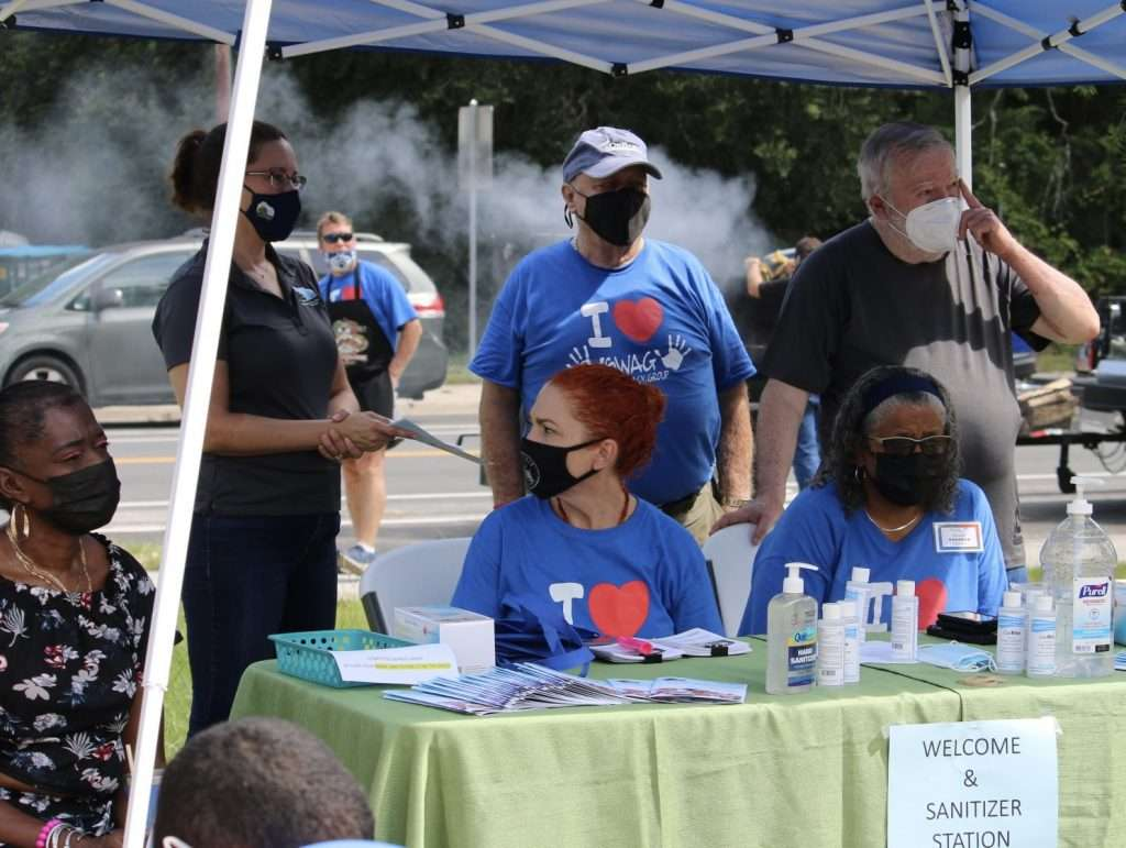 SWAG board members and other volunteers staff a masking and sanitizing station at the Community Connections resource fair