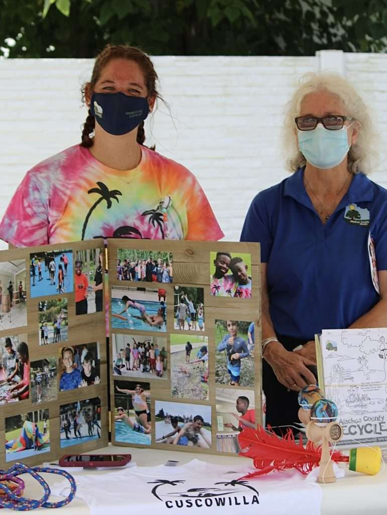 Alachua BoCC Vice Chair Marihelen Wheeler stands with the county staff member running a resource booth for Cuscowilla
