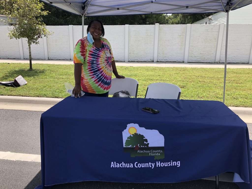 A County staff member runs a booth for Alachua County Housing during the Community Connections resource fair