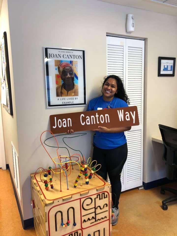 SWAG Board Member Mona Sayedul Huq holds the new Joan Canton Way sign